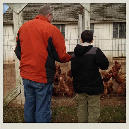fish-family-farm-chicken-coup-chris-feeding