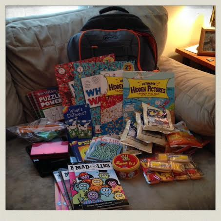 Back-pack-travel-entertainment-kids-books-electronics-snacks
