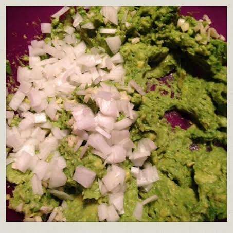 homemade-guacamole-added-chopped-onion