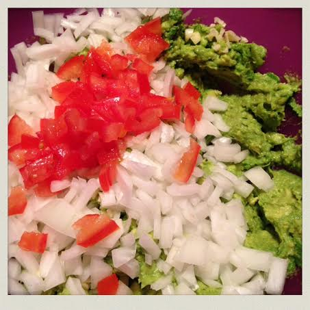 homemade-guacamole-ingredients-added-chopped-tomato