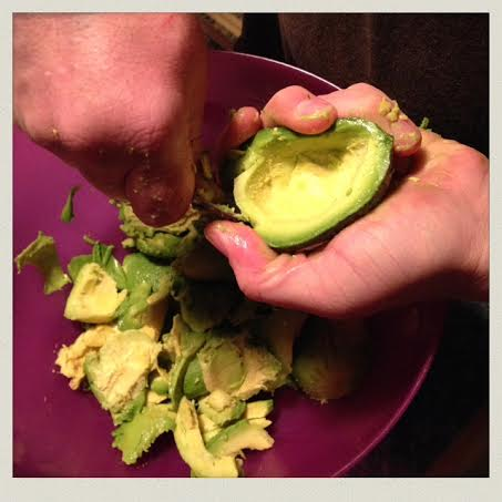 homemade-guacamole-scooping-close-use