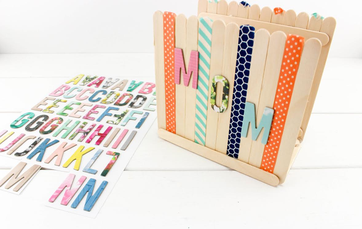 Stickers spell MOM on craft stick napkin holder