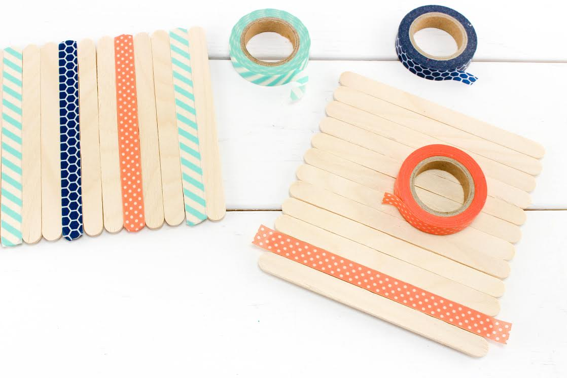 craft stick napkin holder decorated with washi tape