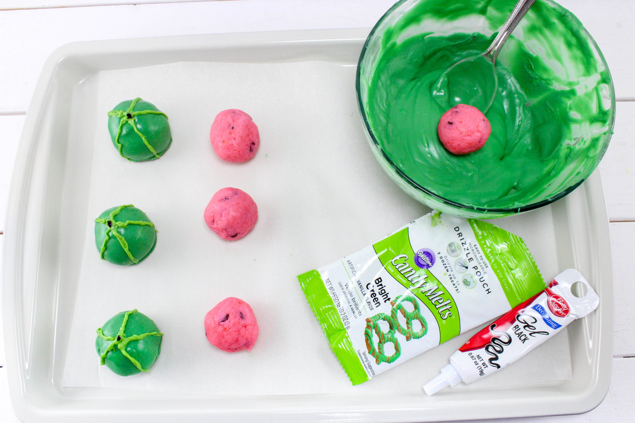These Watermelon Cake Balls will be the hit of your summertime cookout! They don't taste like watermelon, but look the part and are super easy to make