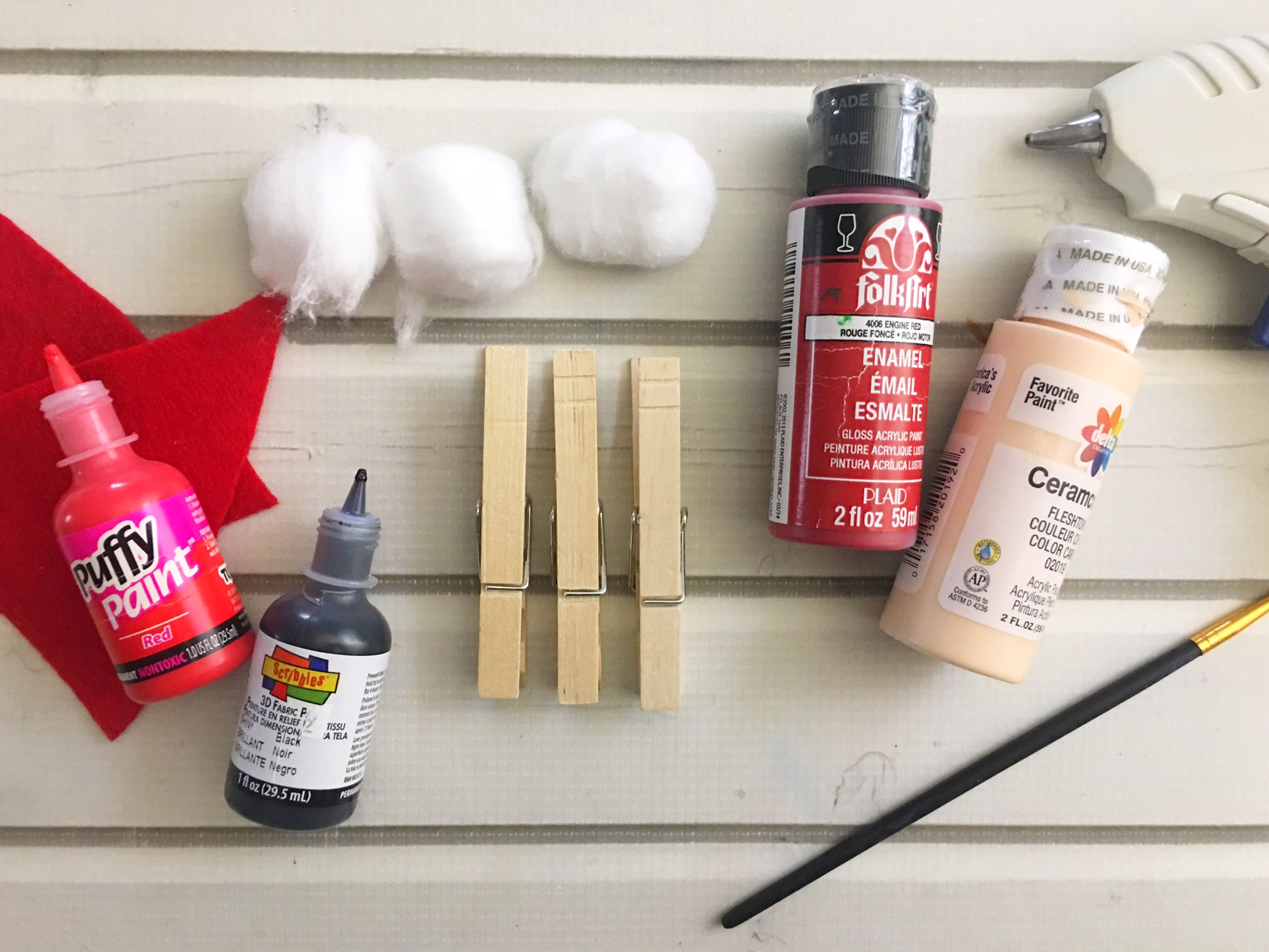 Keep the kids busy with this adorable Santa Claus Clothespin Craft. It's easy to make and you can even add some string to make it into a Christmas ornament.