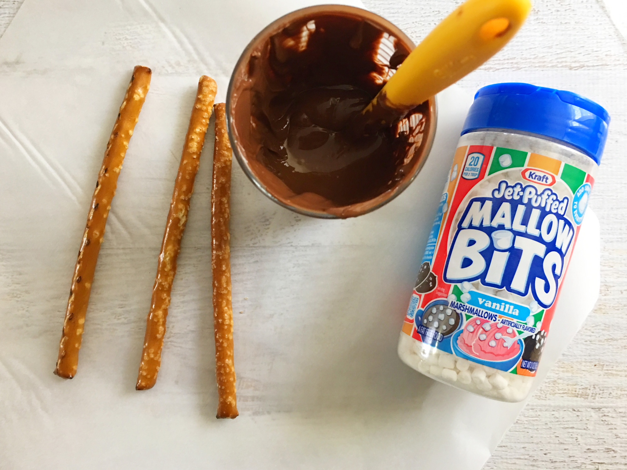 If you're looking for a fun wintery treat, try these Hot Chocolate Pretzel Rods! They are super easy to make and will satisfy your salty and sweet cravings!