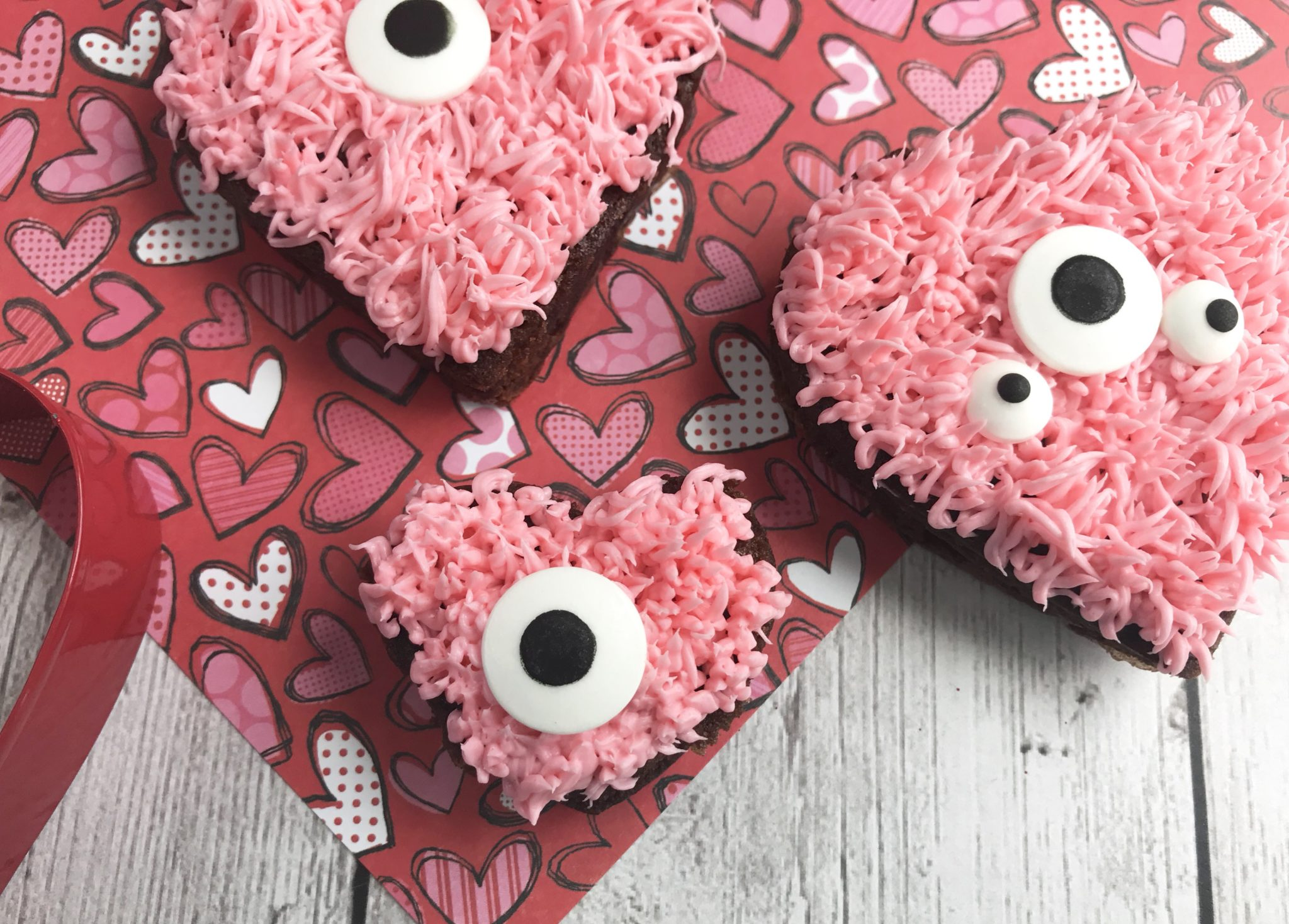 Celebrate Valentine's Day with Some Monster Brownies! They are easy to make & decorate and are a super fun way to celebrate the day with your loved ones.