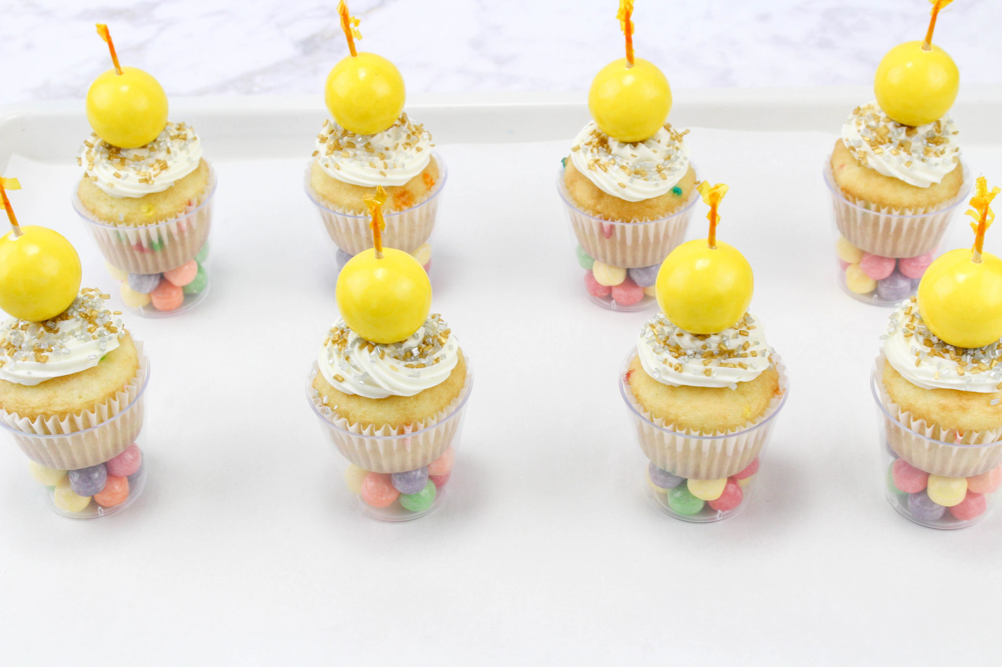 If you're looking for a fun sweet treat to serve on New Year's Eve, try making some of these New Year's Eve Ball Drop Cupcakes for a festive dessert.