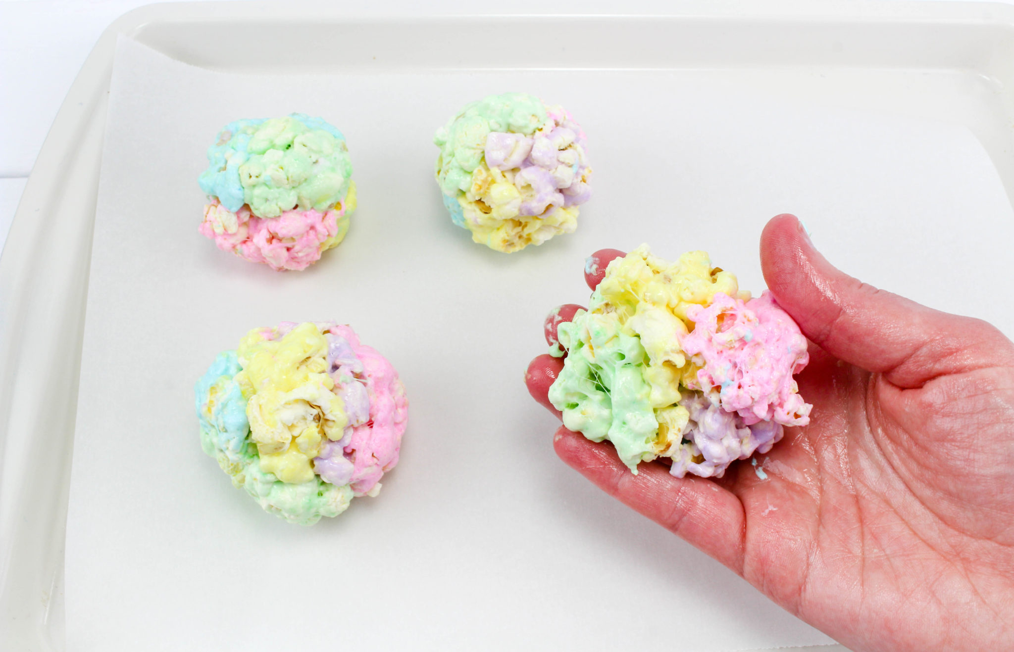 These Peeps Popcorn Balls are a Perfect Easter Treat! They are super easy to make and they are the perfect combination of sweet and salty! Yum.