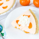 This Orange Fluff Pie is not only DELICIOUS, it is really easy to make and bring with you to all your summer cookouts! It is sure to impress your friends, too!