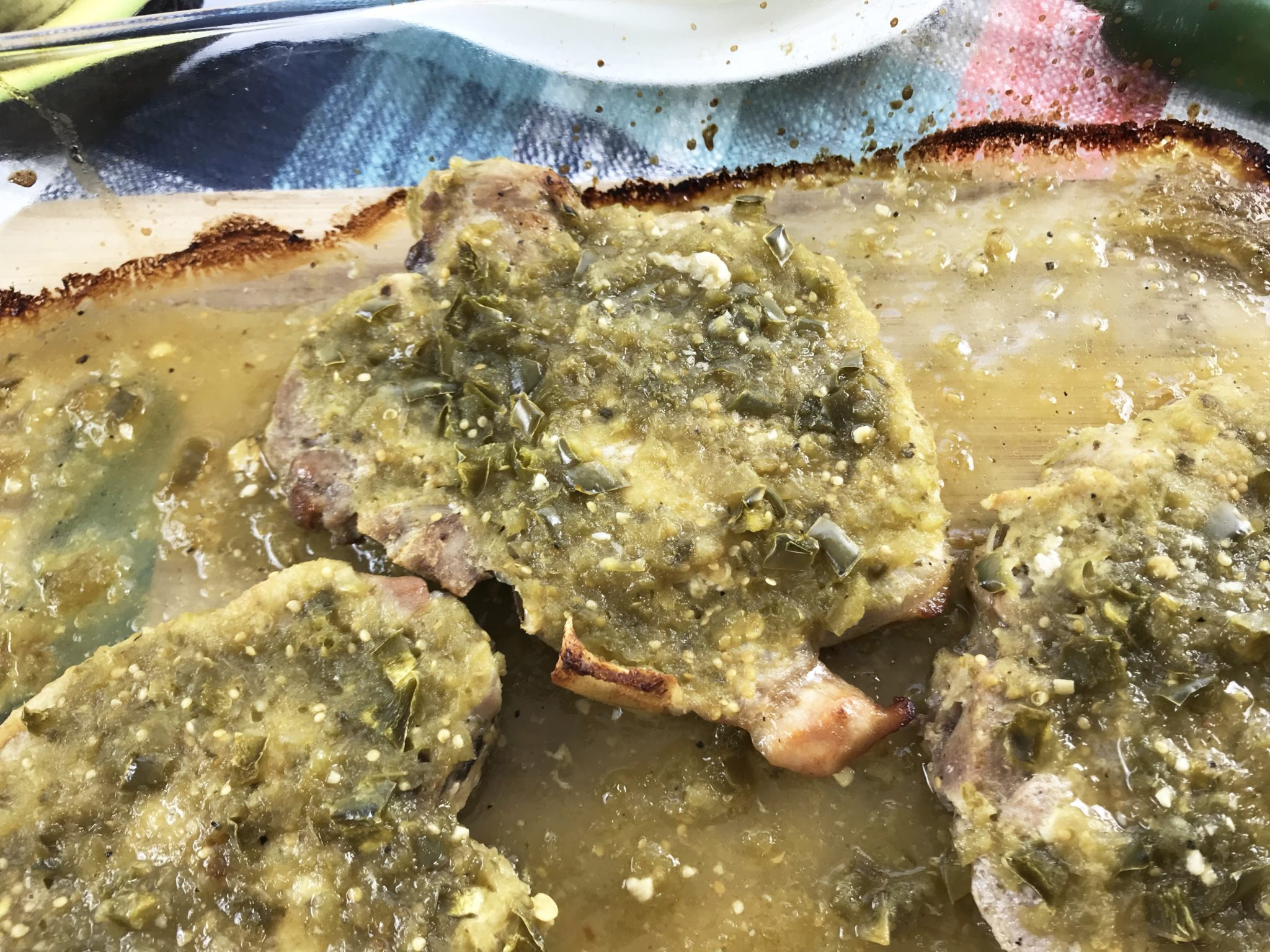 If you're looking for an easy weeknight dinner idea, these salsa verde pork chops are the answer. This recipe can be made quickly and it's delicious!