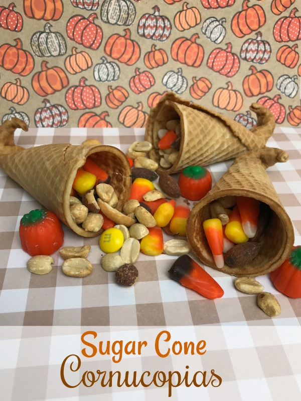 If you're looking for something fun to put on the kids table this Thanksgiving, these Sugar Cone Cornucopias will make a fun addition to your tablescape.