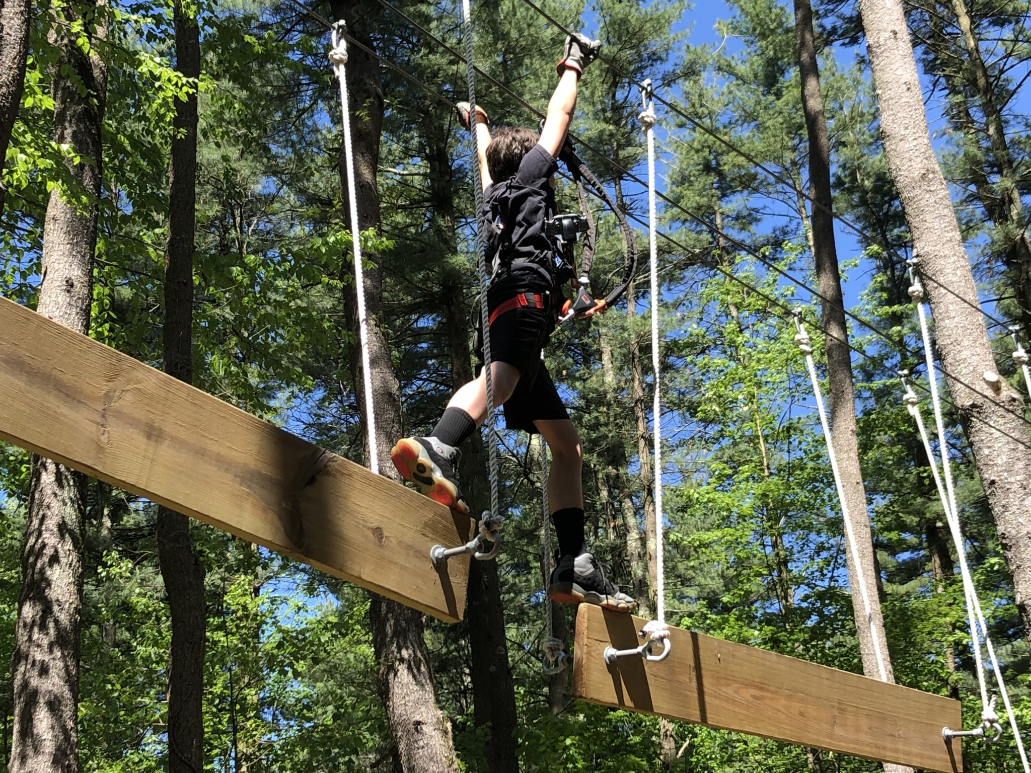 Boundless Adventures Aerial Park is a FUN all level ropes course in western Massachusetts. Spend the day traversing the course with your family this summer.