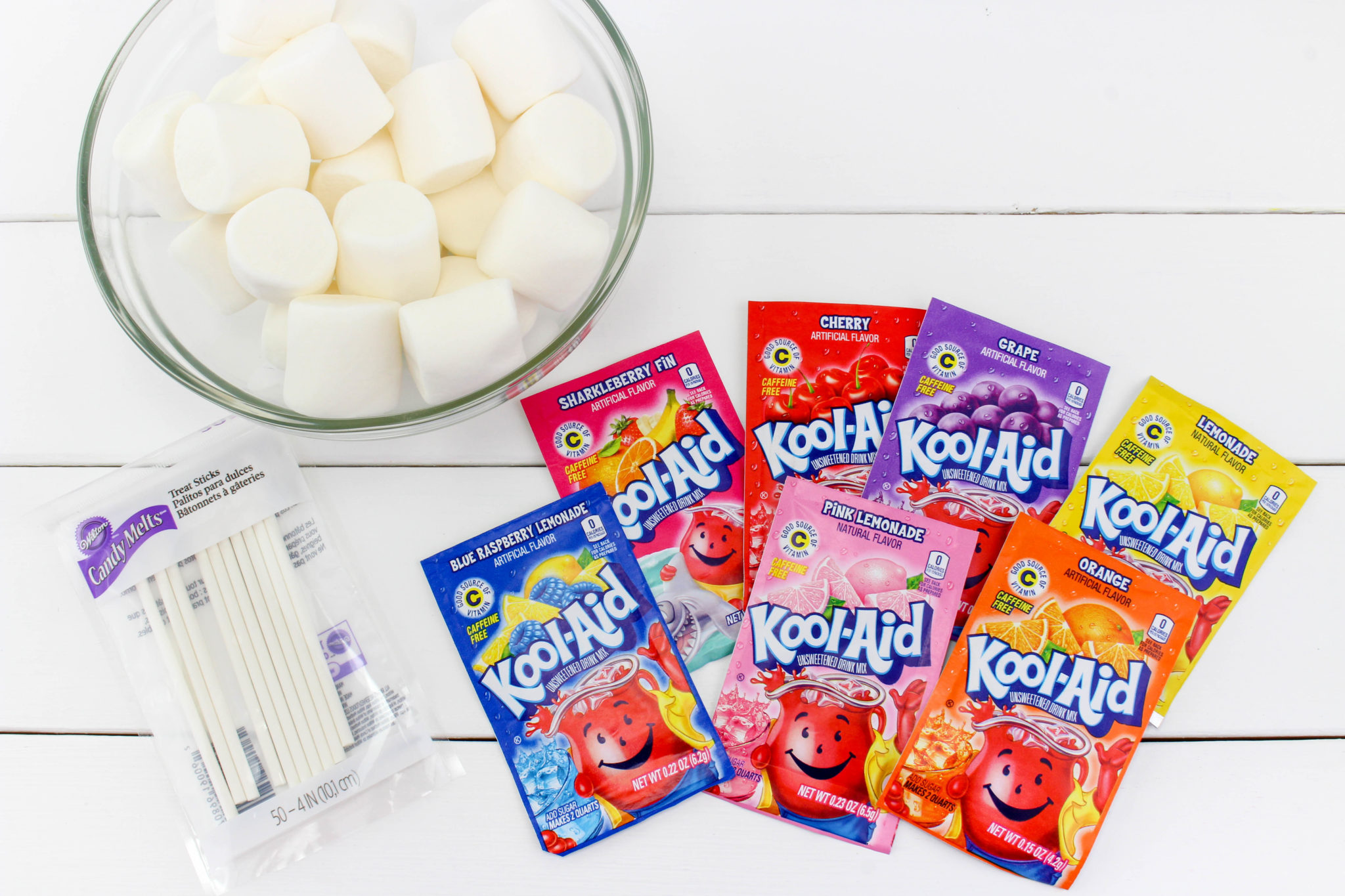 If you are looking for an easy snack idea to make for the kids this summer, try these Kool-Aid Marshmallow Pops. I promise they will be a huge hit!