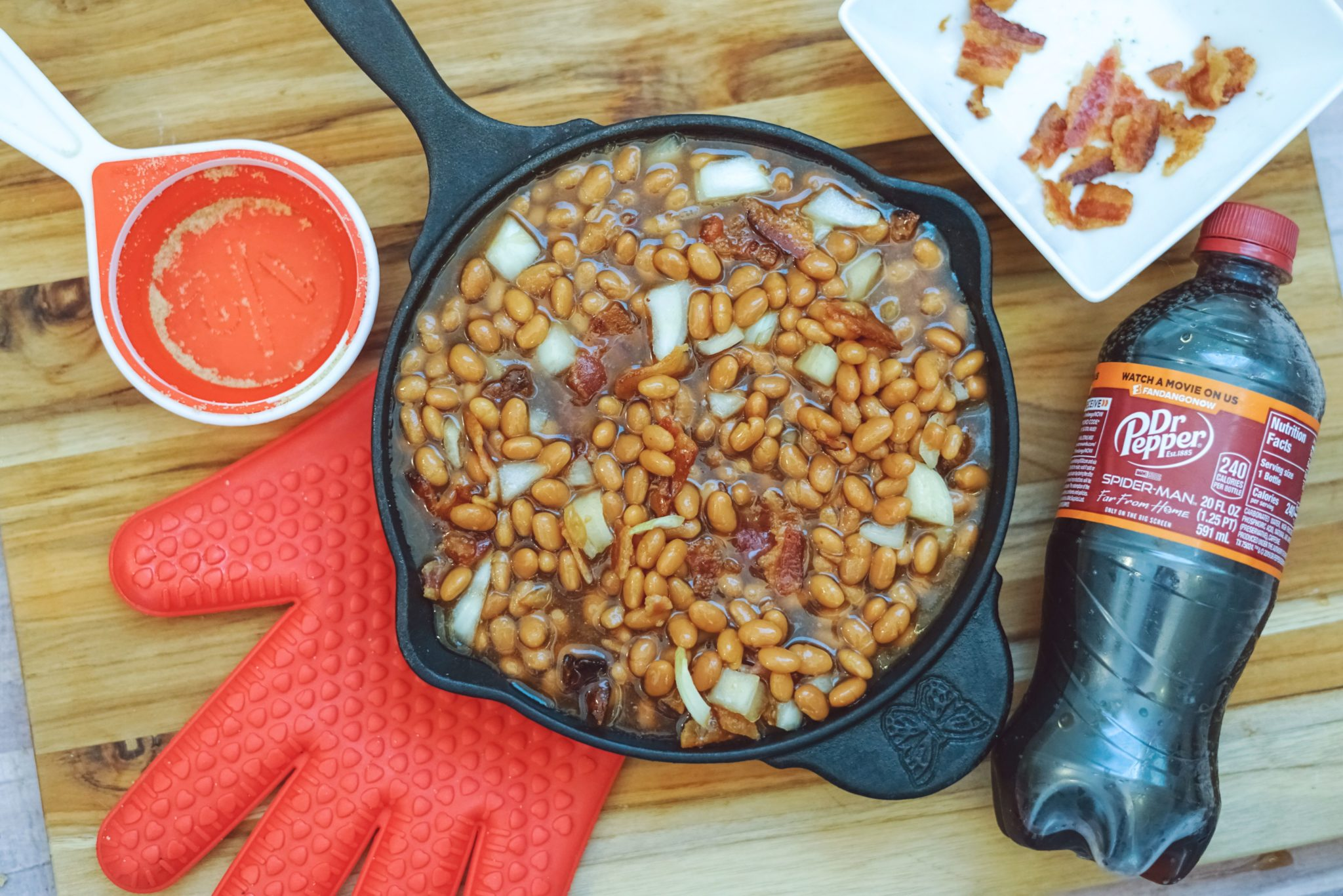 These Dr. Pepper Baked Beans are sweet, delicious and ready in about an hour! They make the perfect meal or an awesome side dish!