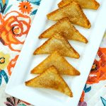 Simple, four ingredient Apple Pie Wontons are crispy apple perfection. The crunch of these mini pies combined with the gooey apple pie filling will make your taste buds happy!