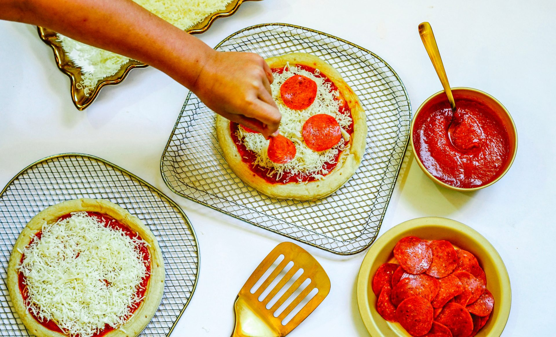 If you want to get your kids more involved in the kitchen, this Air Fryer Pizza recipe is a great way to get started.